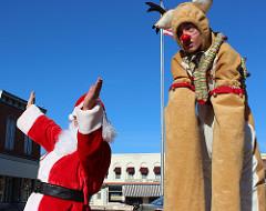 santa and stilt reindeer