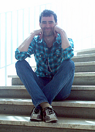 Smiling Bobby sitting on the steps
