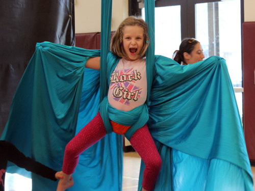 6-year-old girl enjoys aerial silks class