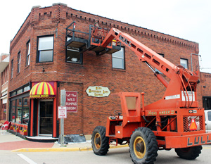 Big cherry picker truck working on the building bricks - infrastructure is important